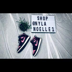 Kids hot pink and black Nike Jordan's
